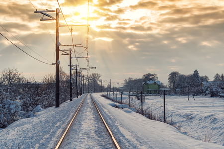 the railway in the snow on beautifull sunset