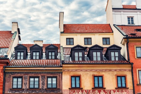 colored vintage roofs of houses with windows in Warsaw