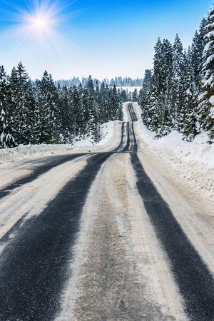 waves on the winter road in Carpathians mountains