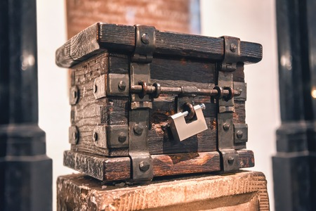 an old wooden chest with padlock