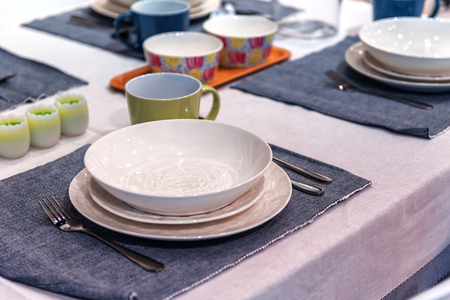 new dishes and cutlery on the table Stock Photo