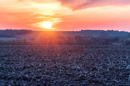 plowed field on beautiful red sunset