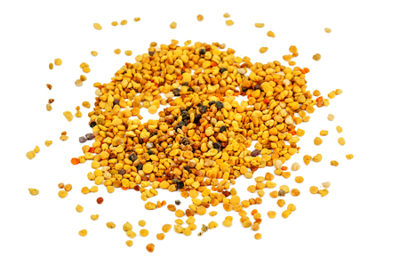 scattered bee pollen isolated on white