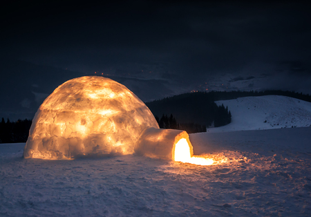light in real snow igloo in winter mountains