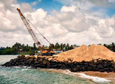 the special crane takes sand from the ocean or sea