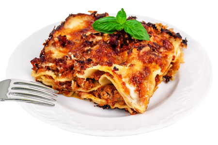 delicious lasagna isolated on white
