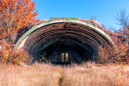 ruins of abandoned military hangar Stock Photo
