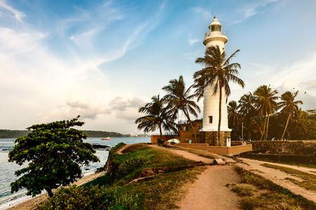 white lighthouse in fort Galle Sri Lanka on sunset Stock Photo