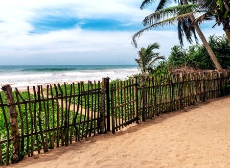wooden fence on the tropical beach of the ocean