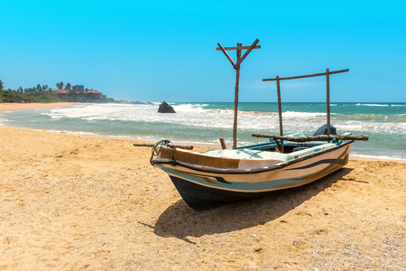 alone fishing boat on the tropical beach
