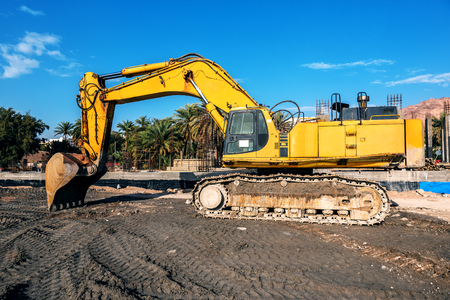 big yellow excavator on construction site