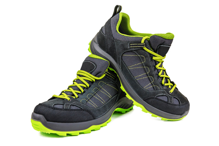 new hiking shoes with green sole isolated on white