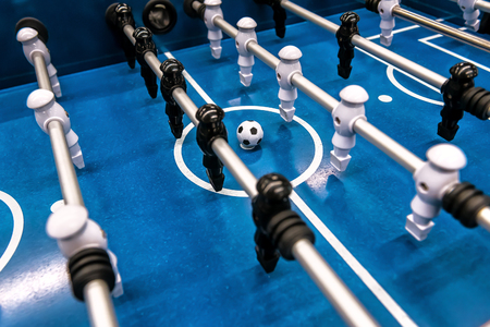 Table football game, Soccer table with black and white players Stockfoto - 125040858
