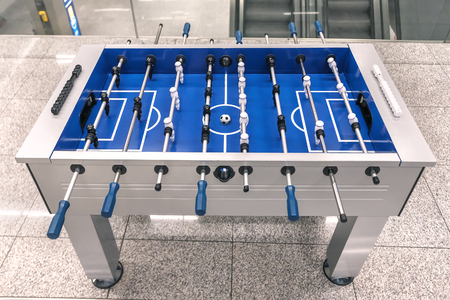 Table football game, Soccer table with black and white players Stockfoto - 125040859
