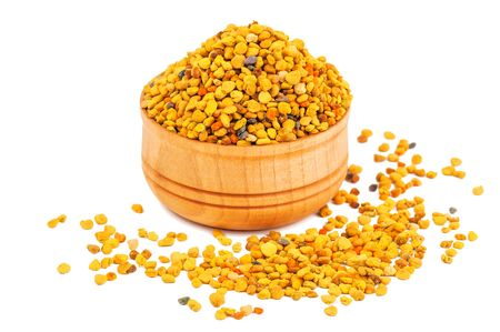 bee pollen in wooden bowl isolated on white Banque d'images - 126378424
