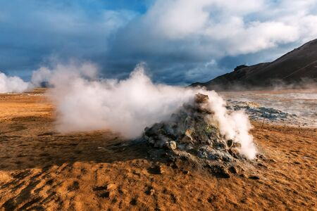 Hverir is geothermal area in Myvatn. Iceland. The steam comes out of the ground Banque d'images - 126380052