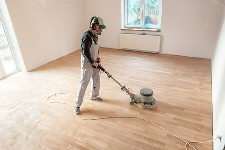 the professional master polishes the parquet with special machine