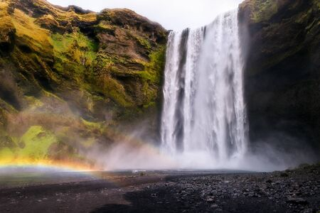Skogafoss waterfall in Iceland with two rainbows Banque d'images - 126379925