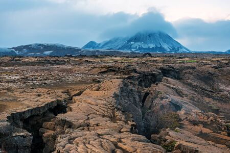 volcano and cracked earth in Iceland Banque d'images - 126378257