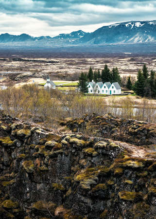 classic Icelandic landscape with mountains and Thingvellir Church