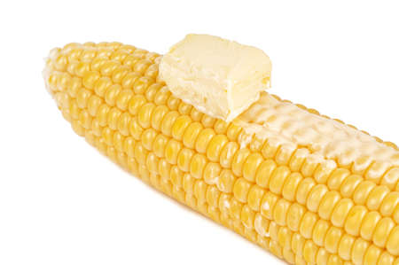 yellow corn cob with butter isolated on white