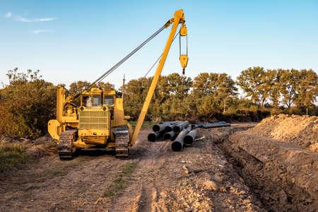 yellow crawler crane and gas pipes 版權商用圖片