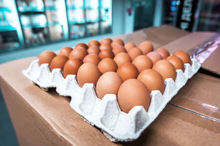 fresh raw brown egg tray in the market
