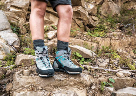 female legs in comfortable hiking boots