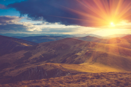 red sun: Beautiful landscape in the mountains at sunshine. Stock Photo