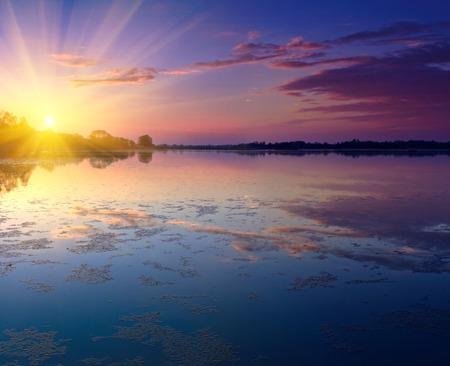 Nice landscape with sunset on lake.