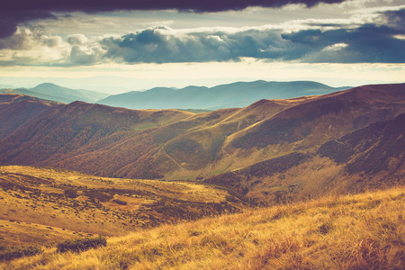 scenic: Scenic view of mountains, autumn landscape with colorful hills at sunset. Stock Photo