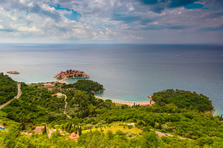 balkans: Landscape of the small island and resort Sveti Stefan.Coast Budva Riviera. Mediterranean sea. Montenegro.View from the top of the mountain. Stock Photo