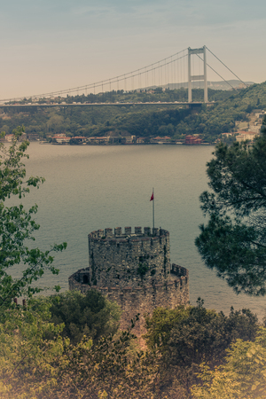 View of Rumelihisar is a fortress located in the Istanbul, Turkey on the hill at the European side of the Bosphorus. Old photo style.