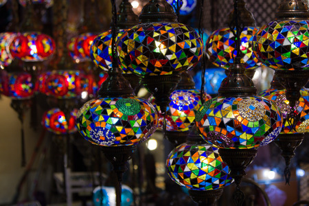 View of traditional bright decorative hanging Turkish lamps and colorful lights with vivid colors in the Grand Bazaar. Istanbul. Turkey. Most popular souvenirs for tourists.