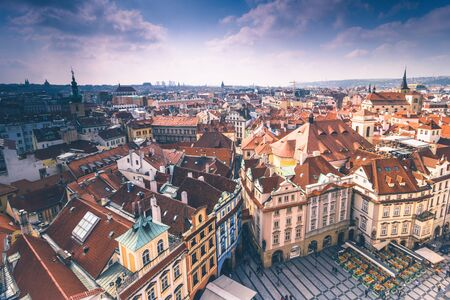 Panoramic view of Prague roofs and domes. Czech Republic. Europe. Filtered image: cross processed retro effect.