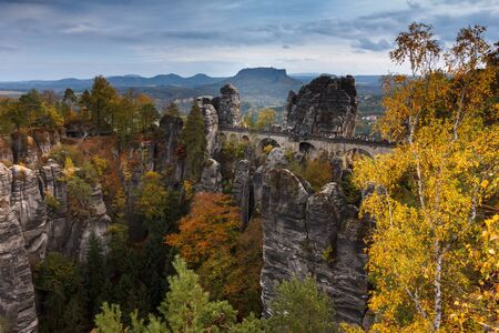 Saxony Bastei Mountains National Park View Exposed sandstone rocks and forest hilly at sunset. Concept of outdoor recreation in natural settings. Stock fotó