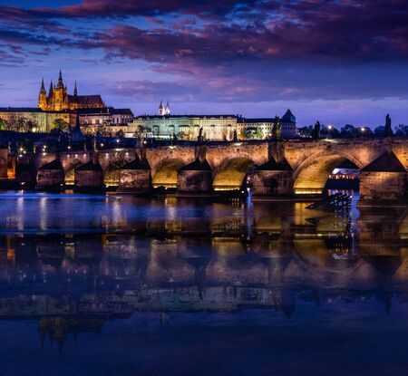 Amazing water reflection of the Charles Bridge (Karluv Most) at dusk on the river. The historic center of Prague, ancient architecture and cultural heritage. Prague. Czech Republic. Reklamní fotografie