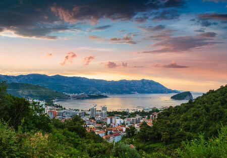Panoramic landscape of Budva riviera in Montenegro at sunrise. Dramatic morning light. Balkans, Adriatic sea, Europe. View from the top of the mountain. Reklamní fotografie