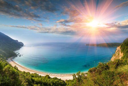 Panoramic landscape of the rocky coastline sea and Jaz Beach at sunshine. Budva, Montenegro. Adriatica. Top view.