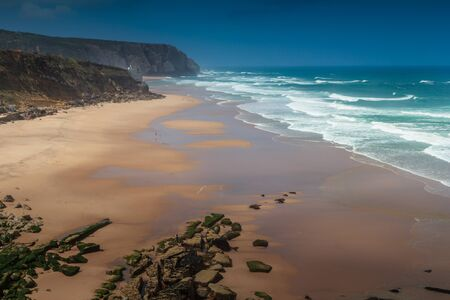 Beautiful landscape of rugged coastline with waves crashing against the cliffs. View of seascape coast and Atlantic ocean waves in a north winds days in Portugal.