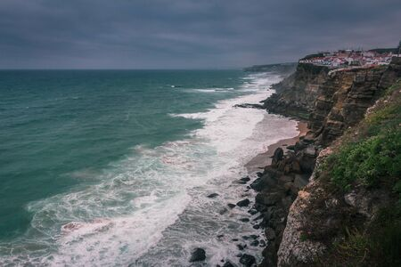 View of beach with large waves near Atlantic coast. Large waves of turquoise water crushing on a beach Praia Grande, Sintra, Portugal. Travel concept. Vintage effect. Reklamní fotografie