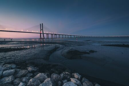 View of amazing Vasco da Gama Bridge at sunset. The Vasco da Gama Bridge crosses the Tagus River, and is one of the longest bridges in the world. Lisbon. Portugal.