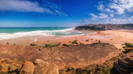 Panorama of the beach of Praia das Macas. View of the The beach is excellent with golden sand and clear sea water, big waves. Coast of the Atlantic Ocean. Portugal. Reklamní fotografie