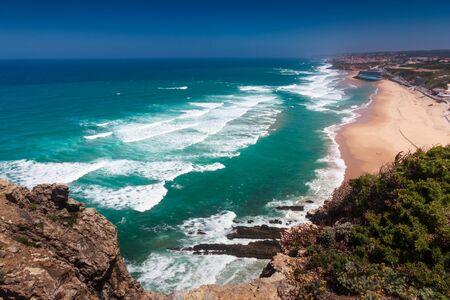 Amazing landscape of the beach of Praia Grande. View of Atlantic coastline - a long sandy beach and big waves. Sintra. Portuguese riviera. Portugal.