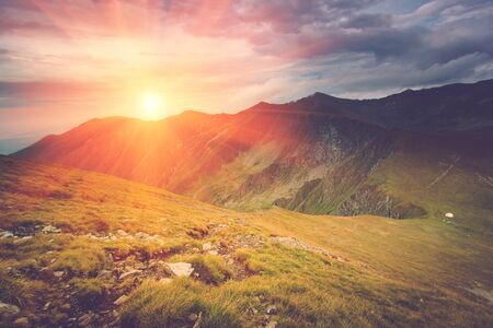 Scenic view of mountains, autumn landscape with colorful hills at sunset. Filtered image: cross processed vintage effect.