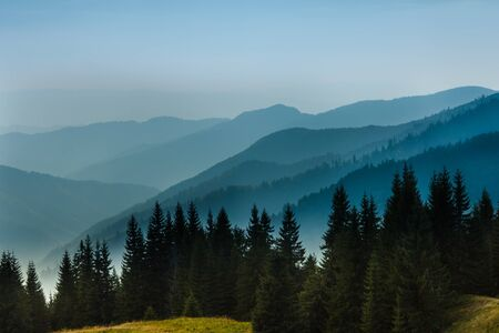 Majestic landscape of summer mountains. A view of the misty slopes of the mountains in the distance. Travel background. Reklamní fotografie