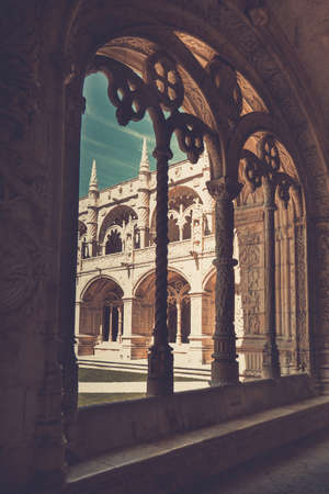 Beautiful reticulated vaulting and columns of Hieronymites Monastery. Manueline architecture style. Famous Lisbon landmark in Belem district and Unesco Heritage. Portugal. Vintage effect.