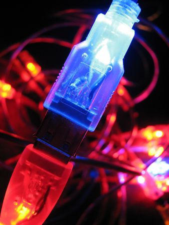 Luminous usb wires. Computer connection. New technologies photo