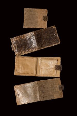 black boa: Several brown purse made of snake skin on a black background
