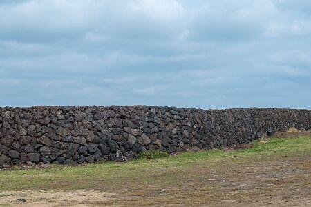 stonewall landscape in Jeju island